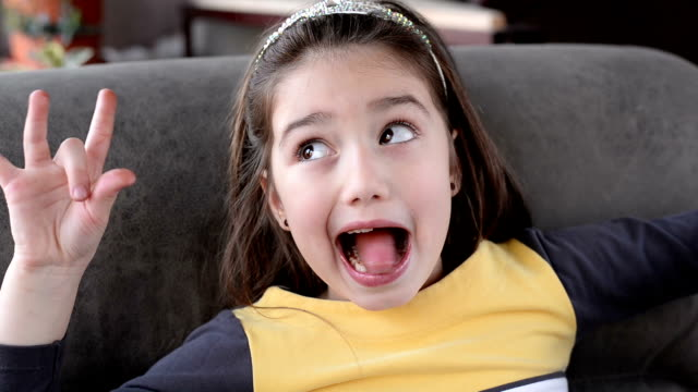 girl making a face - pulling funny faces stock videos & royalty-free footage