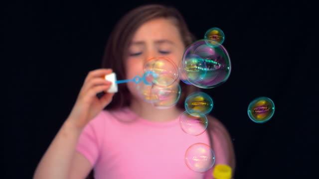 Girl making bubbles in slow motion