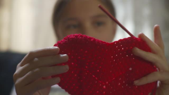 CU TD R/F Girl (10-11) making crochet heart / Newark, Illinois, USA