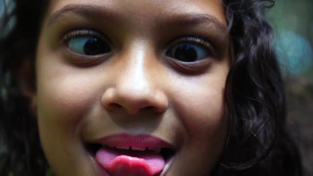 girl making funny faces - grimacing stock videos & royalty-free footage