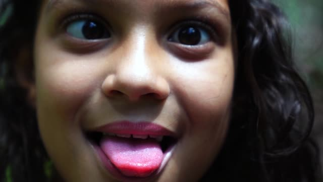 girl making funny faces - careless stock videos & royalty-free footage