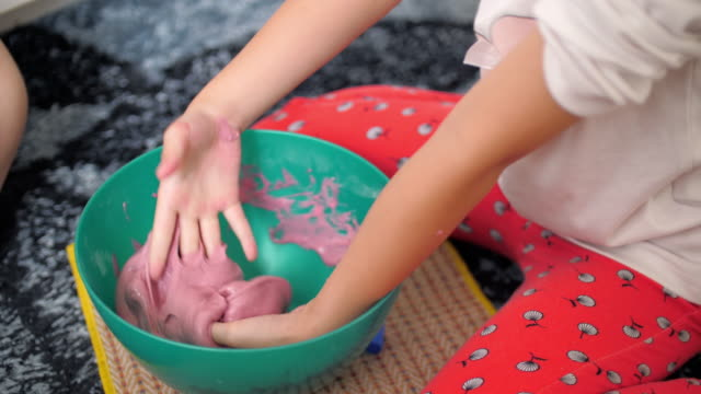 girl making slime at home - slimy stock videos & royalty-free footage