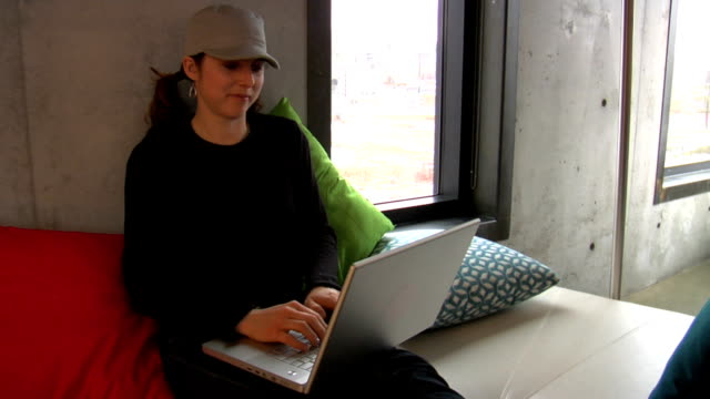girl messaging on laptop - cushion stock videos and b-roll footage