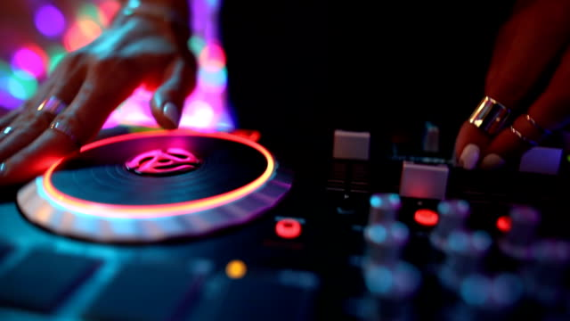 dj girl mixing modern turntable. dj hands on mixer, dancing and playing music, close up - compact disc player stock videos & royalty-free footage