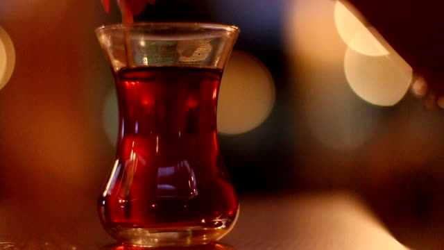 Girl mixing Turkish tea