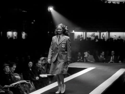 a girl models a school uniform at a fashion show for teenagers - school uniform stock videos & royalty-free footage