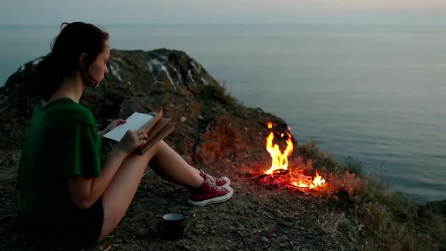 girl near campfire - human limb stock videos & royalty-free footage