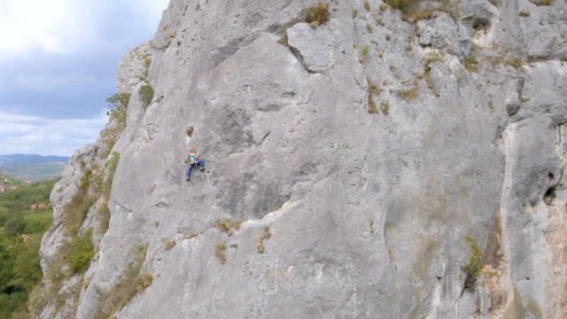 girl on a mission - rock face stock videos and b-roll footage