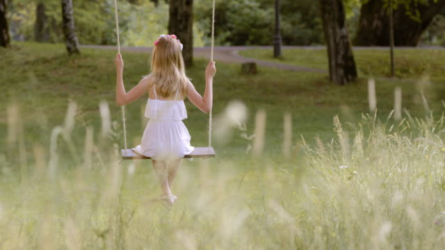 slo mo ds girl on a swing in nature - innocence stock videos and b-roll footage