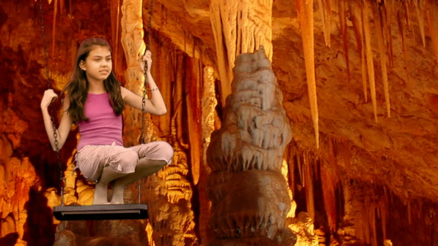 girl on a swing in stalactite cave - cave stock videos & royalty-free footage