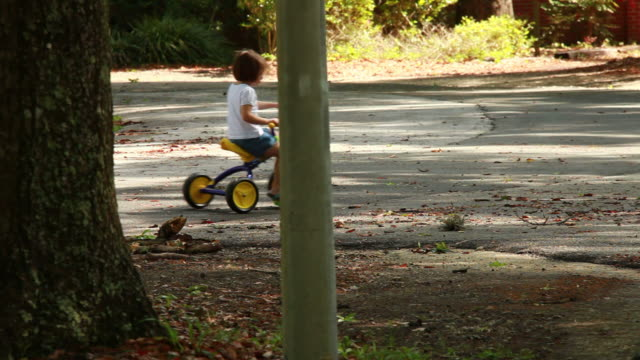 girl on a tricycle - tricycle stock videos & royalty-free footage