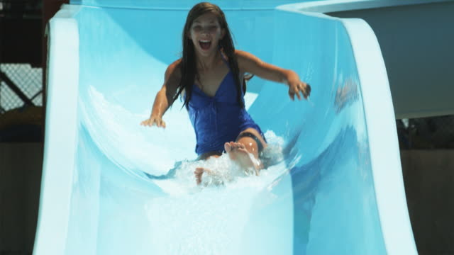 girl on a waterslide - water slide stock videos & royalty-free footage