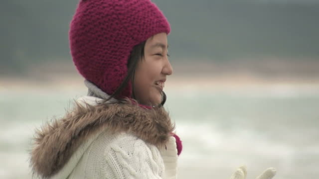 girl on beach - woolly hat stock videos & royalty-free footage