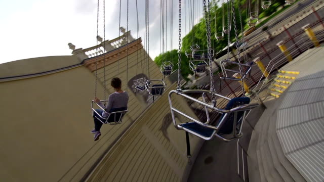 girl on chairoplane in an amusement park - roundabout stock videos & royalty-free footage