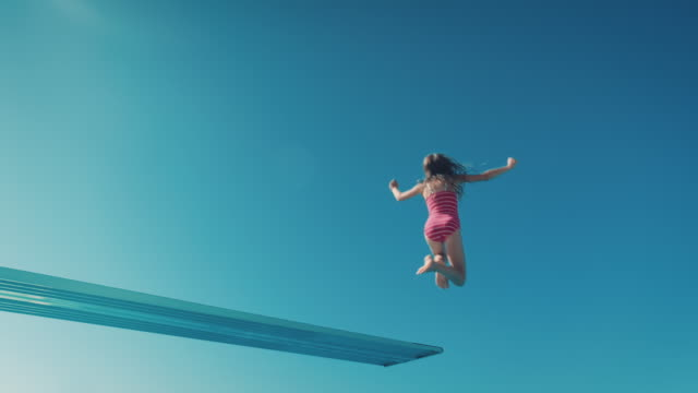 girl on diving board - diving into water stock videos & royalty-free footage