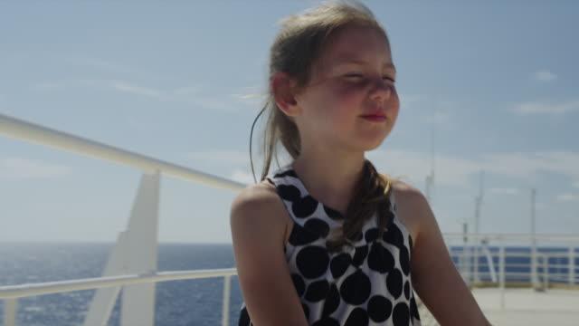 vídeos y material grabado en eventos de stock de slo mo ms pan girl (6-7) on ship deck / caribbean - crucero barco de pasajeros