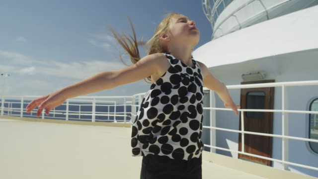 slo mo ms girl (6-7) on ship deck / caribbean - cruise stock videos & royalty-free footage