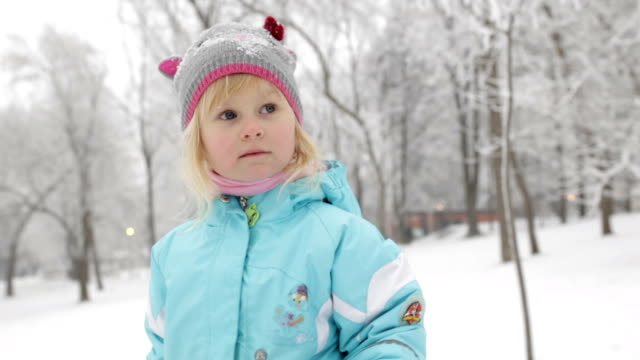 Girl on snow in the park