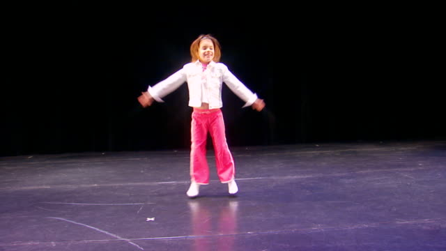 girl on stage doing jumping jacks - star jump stock videos & royalty-free footage