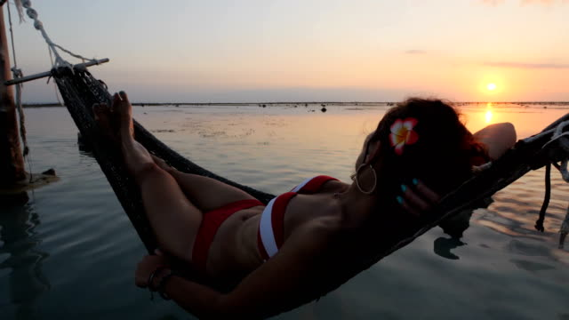 girl on swing at the beach in gili trawangan island in bali - bali stock videos & royalty-free footage