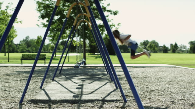 ws pan girl (10-11) on swing in park / orem, utah, usa - orem utah stock videos & royalty-free footage