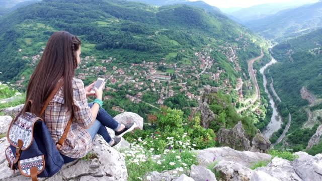 Girl on the mountain peak