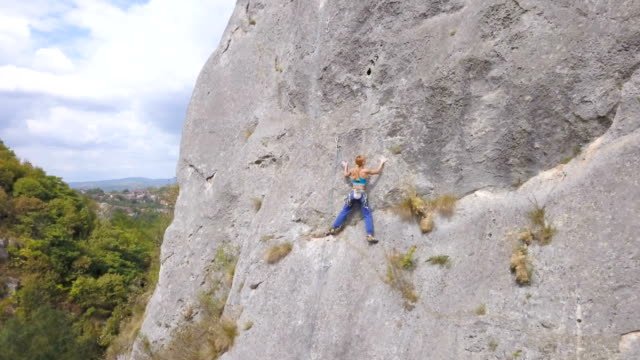 girl on the rocks - rock face stock videos and b-roll footage