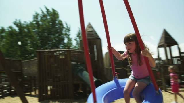 ms girl (2-3) on tire swing in park, american fork, utah, usa - tire swing stock videos & royalty-free footage