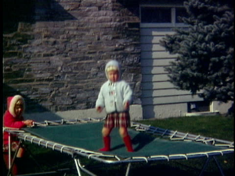 stockvideo's en b-roll-footage met 1966 ws cu composite girl (2-3) on trampoline in garden, middlebury, vermont, usa - trampoline