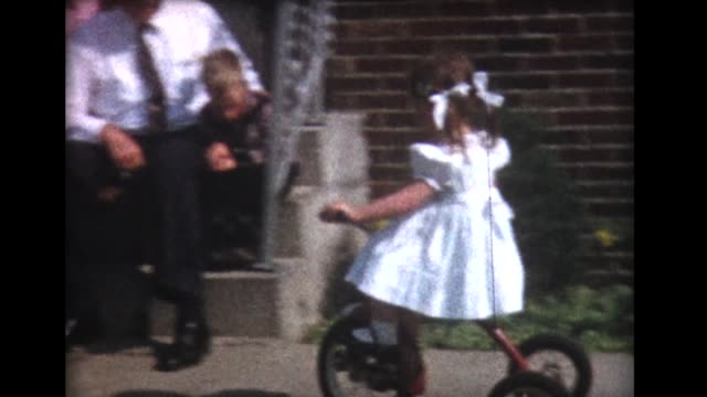 1960 girl on tricycle, family on steps - tricycle stock videos and b-roll footage