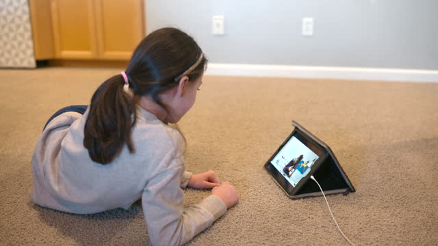 girl on video call with teacher - digital native stock videos & royalty-free footage