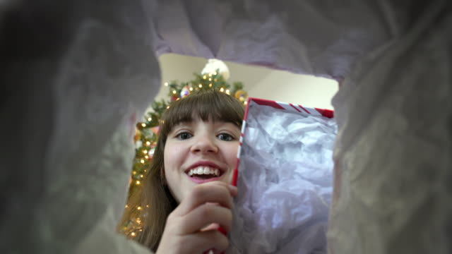 Girl opening a Christmas present