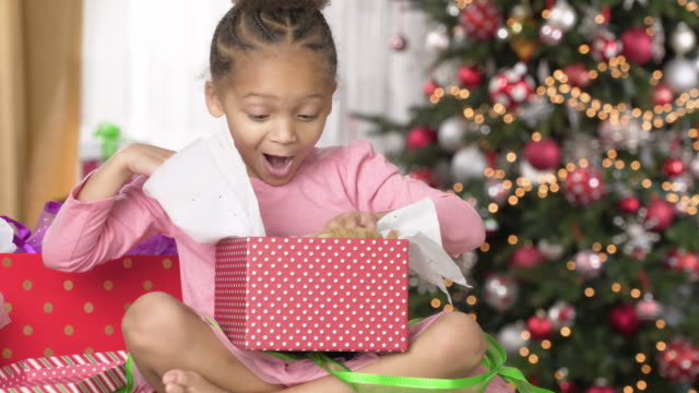 girl opening christmas gift - gift stock videos and b-roll footage