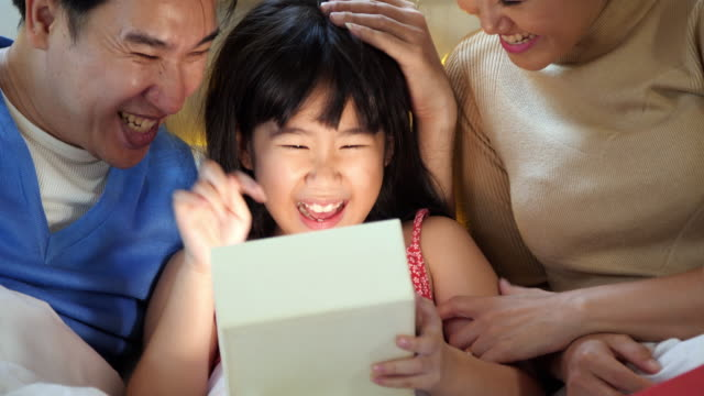 girl opening christmas present,little girl with gift - gift stock videos & royalty-free footage