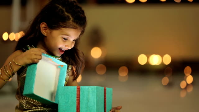 ms girl opening gift during diwali festival - indian ethnicity stock videos & royalty-free footage