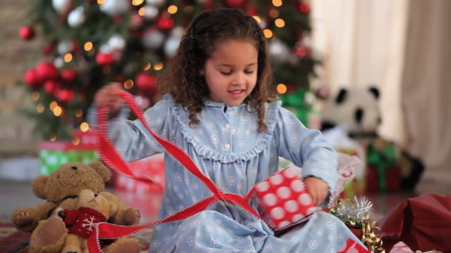 ms tu girl (4-5) opening presents on christmas morning / richmond, virginia, usa - christmas gift stock videos and b-roll footage