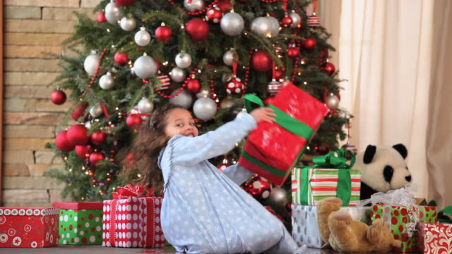 ws tu girl (4-5) opening presents on christmas morning / richmond, virginia, usa - child sitting cross legged stock videos & royalty-free footage