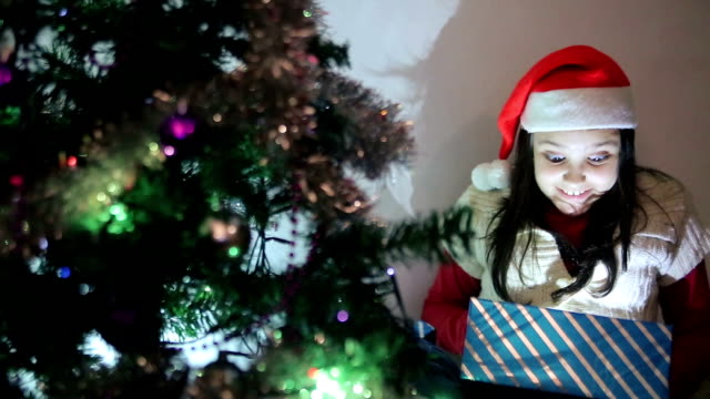 girl opens a gift for christmas - little girls flashing stock videos and b-roll footage