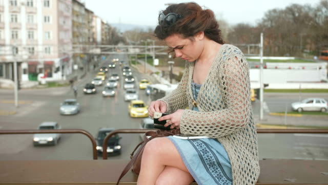 Girl outdoors shopping online on her smart phone