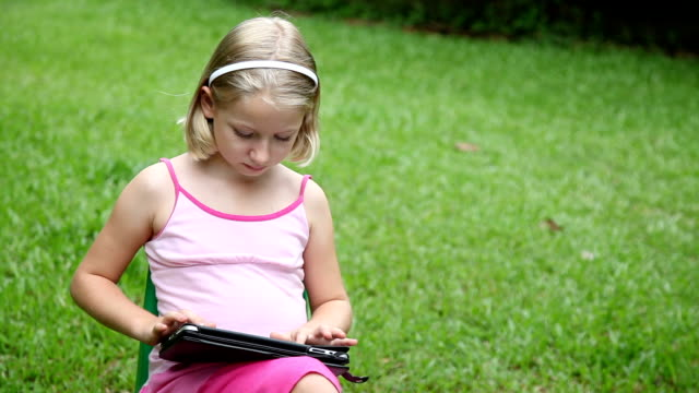 girl outdoors using with tablet computer ipad - 8 9 years stock videos and b-roll footage
