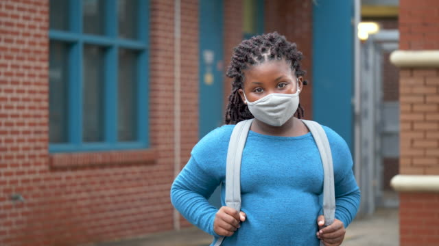 girl outside elementary school wearing face mask - braided hair stock videos & royalty-free footage