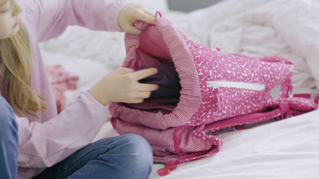 vídeos y material grabado en eventos de stock de girl packing backpack - rucksack