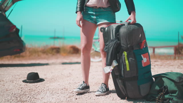girl packs clothes into a backpack - travel destinations video stock e b–roll