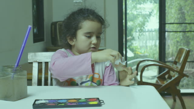 girl painting easter eggs at home - gouache stock videos & royalty-free footage