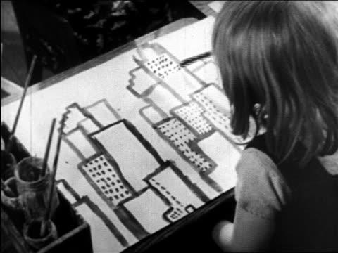 stockvideo's en b-roll-footage met b/w 1945 rear view girl painting skyscrapers / educational - alleen meisjes