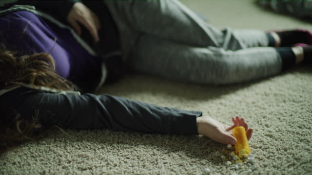 Girl passed out on floor from overdose of pills / Cedar Hills, Utah, United States