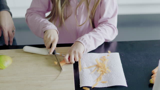 girl peeling carrot - möhre stock-videos und b-roll-filmmaterial