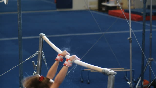 ms girl (12-13) performing gymnastics / lindon, utah, usa.  - horizontal bar stock videos and b-roll footage