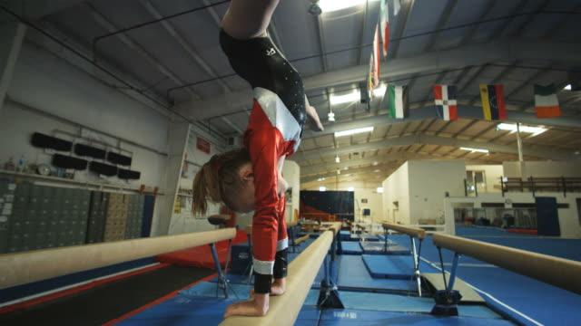 WS Girl (12-13) performing gymnastics on balance beam / Lindon, Utah, USA.