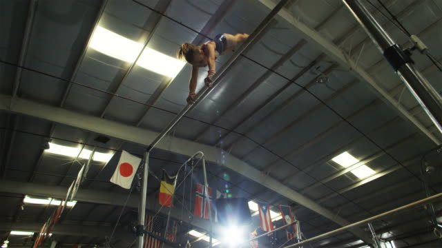 ws girl (12-13) performing gymnastics on high bar / lindon, utah, usa. - gymnastics stock videos & royalty-free footage